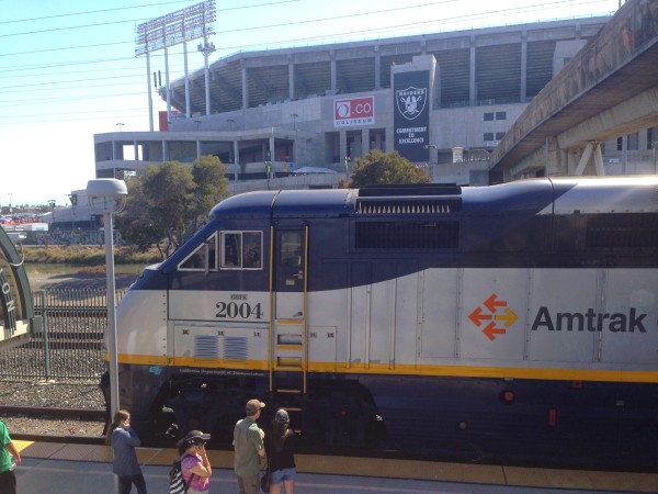 An Amtrak California train passes by O.co Coliseum on Aug. 2, 2014.