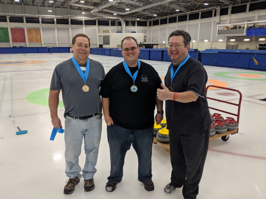 "The members of Team 20/20 --- from the left, Joe, Andrew and Ryan --- pose after receiving medals for winning the ""B"" bracket during the winter 2018 Monday curling league at the Utah Olympic Oval."